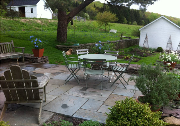 Patio relates to vegetable garden and out building