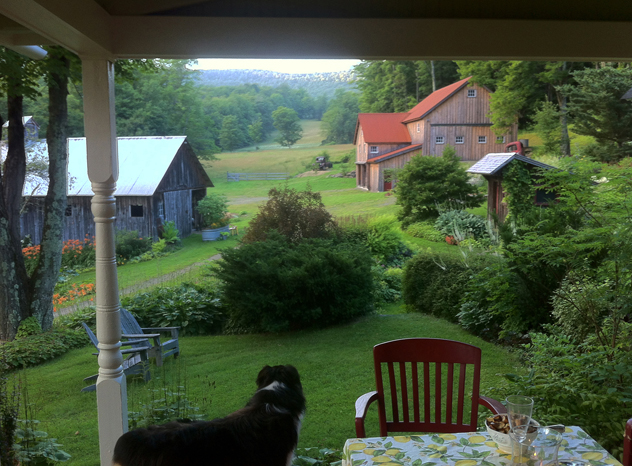 "Mermer Blakeslee's garden with a ""borrowed view"" from the porch."