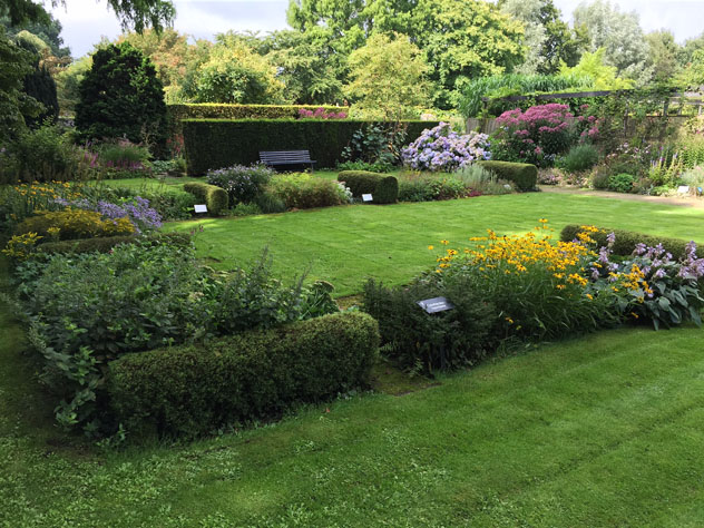 Use of hedges create strong lines in the garden composition.
